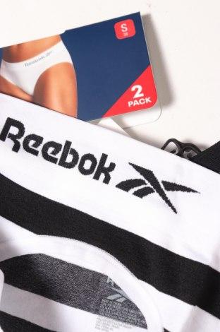 Дамски комплект Reebok, Размер M, Цвят Черен, 89% полиамид, 10% еластан, 1% полиестер, Цена 11,88лв.