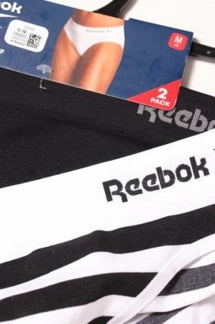 Дамски комплект Reebok, Размер M, Цвят Черен, 89% полиамид, 10% еластан, 1% полиестер, Цена 14,70лв.