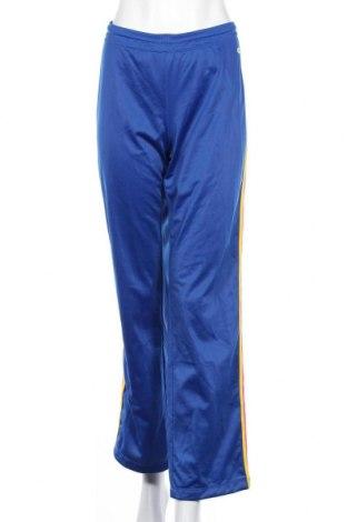 Γυναικείο αθλητικό παντελόνι Champion, Μέγεθος L, Χρώμα Μπλέ, Πολυεστέρας, Τιμή 11,72€