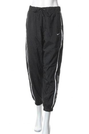 Γυναικείο αθλητικό παντελόνι Nike, Μέγεθος L, Χρώμα Μαύρο, Πολυαμίδη, Τιμή 52,02€