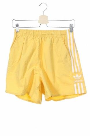 Γυναικείο κοντό παντελόνι Adidas Originals, Μέγεθος XS, Χρώμα Κίτρινο, Πολυαμίδη, Τιμή 26,68€
