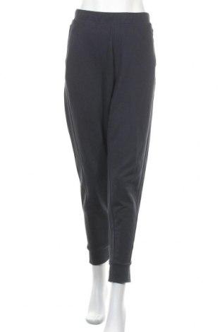 Дамско спортно долнище Calvin Klein, Размер L, Цвят Син, Памук, Цена 81,75лв.