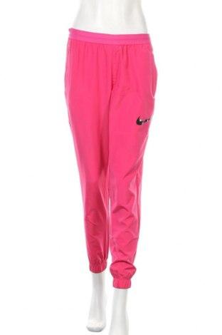 Γυναικείο αθλητικό παντελόνι Nike, Μέγεθος S, Χρώμα Ρόζ , Πολυεστέρας, Τιμή 37,25€