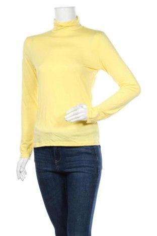 Дамска блуза Uniqlo, Размер L, Цвят Жълт, 39% акрил, 33% полиестер, 20% вискоза, 8% еластан, Цена 13,39лв.