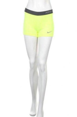 Γυναικείο κολάν Nike, Μέγεθος M, Χρώμα Κίτρινο, Τιμή 18,19€