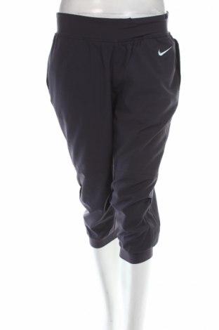 Dámske tepláky Nike, Veľkosť M, Farba Modrá, Polyester, Cena  8,42€