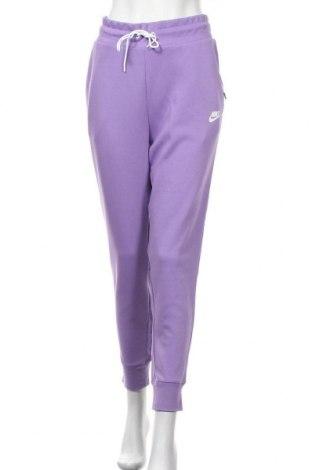Γυναικείο αθλητικό παντελόνι Nike, Μέγεθος M, Χρώμα Βιολετί, 69% βαμβάκι, 31% πολυεστέρας, Τιμή 38,27€