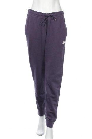 Дамско спортно долнище Nike, Размер M, Цвят Лилав, 80% памук, 20% полиестер, Цена 47,52лв.