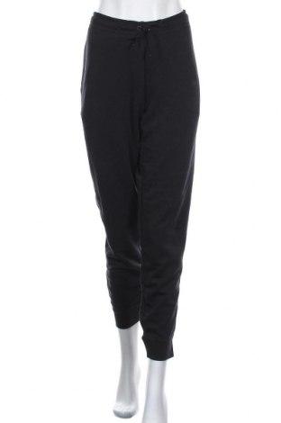 Дамско спортно долнище Nike, Размер L, Цвят Черен, 80% памук, 20% полиестер, Цена 72,27лв.