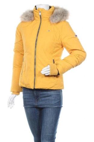 Γυναικείο μπουφάν Tommy Hilfiger, Μέγεθος S, Χρώμα Κίτρινο, Πολυεστέρας, φτερά και πούπουλα, Τιμή 205,67€