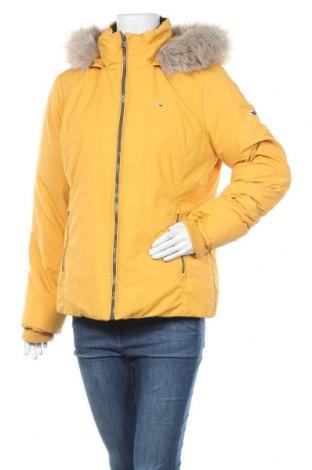 Γυναικείο μπουφάν Tommy Hilfiger, Μέγεθος XL, Χρώμα Κίτρινο, Πολυεστέρας, φτερά και πούπουλα, Τιμή 195,36€