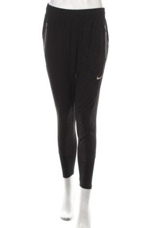 Dámske tepláky Nike, Veľkosť S, Farba Čierna, 78% polyester, 22% elastan, Cena  45,88€