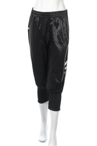 Дамско спортно долнище Hummel, Размер XL, Цвят Черен, 50% памук, 50% полиестер, Цена 15,44лв.