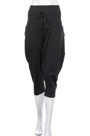 Дамско спортно долнище Reebok, Размер L, Цвят Черен, 88% полиестер, 12% еластан, Цена 23,10лв.