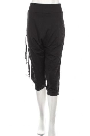 Damskie spodnie sportowe Reebok, Rozmiar XL, Kolor Czarny, 82% poliester, 18% elastyna, Cena 159,30zł