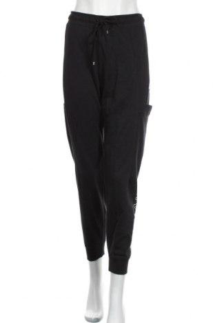 Γυναικείο αθλητικό παντελόνι Nike, Μέγεθος L, Χρώμα Μαύρο, 80% βαμβάκι, 20% πολυεστέρας, Τιμή 34,70€