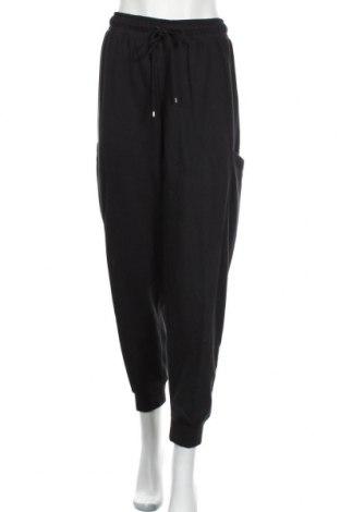 Дамско спортно долнище Nike, Размер XL, Цвят Черен, 80% памук, 20% полиестер, Цена 44,55лв.