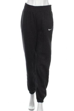 Γυναικείο αθλητικό παντελόνι Nike, Μέγεθος S, Χρώμα Μαύρο, 80% βαμβάκι, 20% πολυεστέρας, Τιμή 34,70€