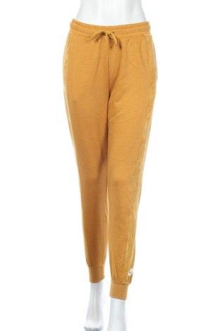 Γυναικείο αθλητικό παντελόνι Nike, Μέγεθος S, Χρώμα Κίτρινο, 52% βαμβάκι, 30% βισκόζη, 18% πολυεστέρας, Τιμή 38,21€