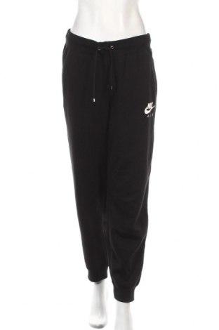 Pantaloni trening de femei Nike, Mărime M, Culoare Negru, 80% bumbac, 20% poliester, Preț 195,05 Lei