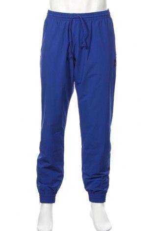 Pantaloni trening de bărbați Adidas Originals, Mărime L, Culoare Albastru, 90% poliamidă, 10% elastan, Preț 195,05 Lei