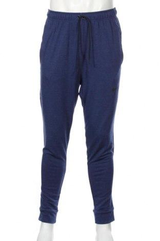 Pantaloni trening de bărbați Nike, Mărime M, Culoare Albastru, 51% viscoză, 43% poliester, 6% elastan, Preț 168,63 Lei