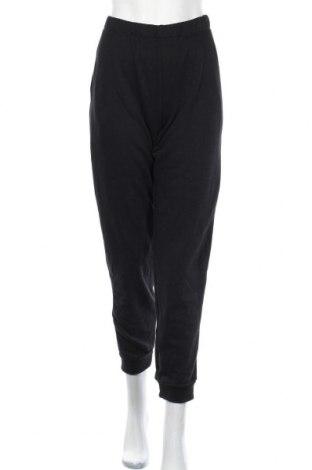 Дамско спортно долнище Decathlon, Размер XL, Цвят Черен, 58% полиестер, 42% памук, Цена 20,95лв.