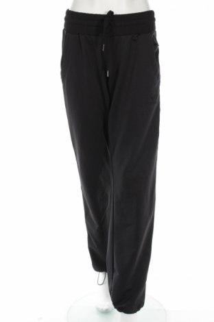 Damskie spodnie sportowe Hummel