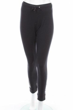 Damskie spodnie sportowe Nike