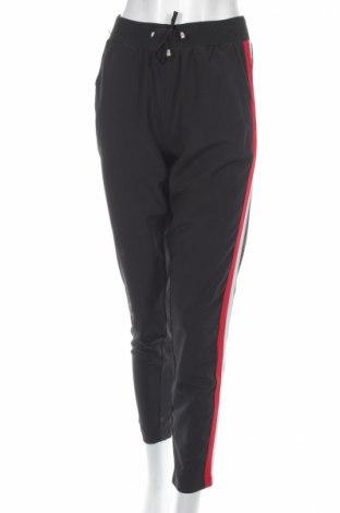 Damskie spodnie sportowe Qed London