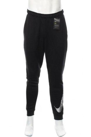 Męskie spodnie sportowe Nike, Rozmiar M, Kolor Czarny, 75% poliester, 25% wiskoza, Cena 185,63zł