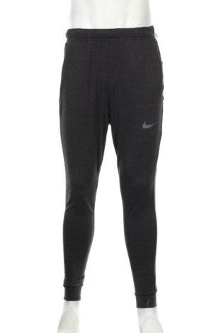 Мъжко спортно долнище Nike, Размер S, Цвят Сив, 49% вискоза, 45% полиестер, 6% еластан, Цена 74,25лв.