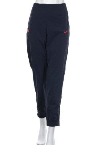 Pantaloni trening de femei Nike, Mărime L, Culoare Albastru, 93% poliamidă, 7% elastan, Preț 151,32 Lei