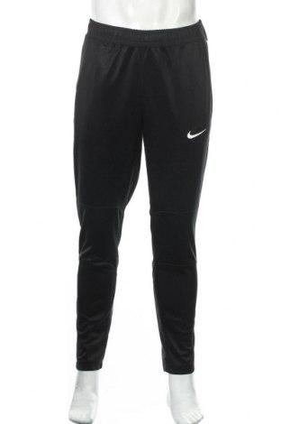 Męskie spodnie sportowe Nike, Rozmiar M, Kolor Czarny, Poliester, Cena 185,63zł