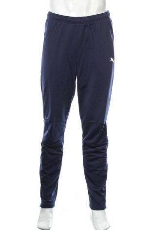 Pantaloni trening de bărbați PUMA, Mărime L, Culoare Albastru, Poliester, Preț 123,75 Lei