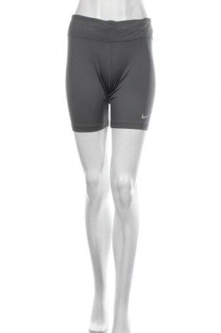 Dámské legíny  Nike, Velikost XL, Barva Šedá, 83% polyester, 17% elastan, Cena  510,00Kč
