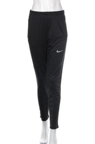 Dámské tepláky Nike, Velikost M, Barva Černá, Cena  558,00Kč