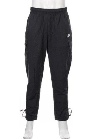 Pantaloni trening de bărbați Nike, Mărime M, Culoare Albastru, 62% bumbac, 38% poliamidă, Preț 226,97 Lei