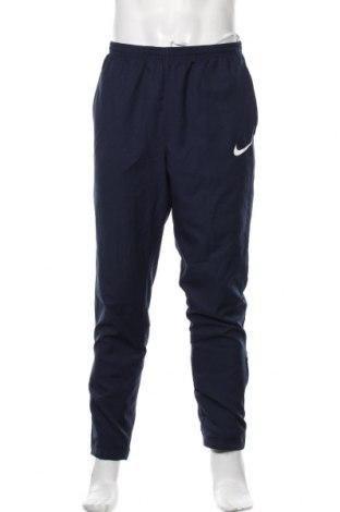 Pantaloni trening de bărbați Nike, Mărime L, Culoare Albastru, Poliester, Preț 126,00 Lei