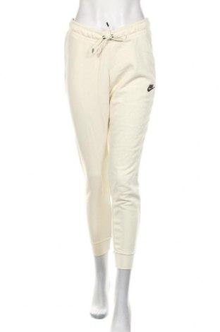 Γυναικείο αθλητικό παντελόνι Nike, Μέγεθος M, Χρώμα Εκρού, 80% βαμβάκι, 20% πολυεστέρας, Τιμή 38,27€