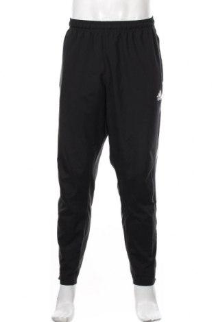 Męskie spodnie sportowe Adidas, Rozmiar XL, Kolor Czarny, 100% poliester, Cena 164,00zł
