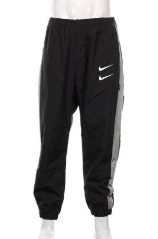 Męskie spodnie sportowe Nike, Rozmiar XL, Kolor Czarny, Poliamid, Cena 198,00zł