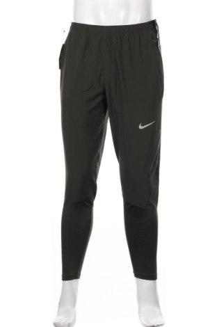 Męskie spodnie sportowe Nike, Rozmiar M, Kolor Zielony, 88% poliester, 12% elastyna, Cena 198,00zł