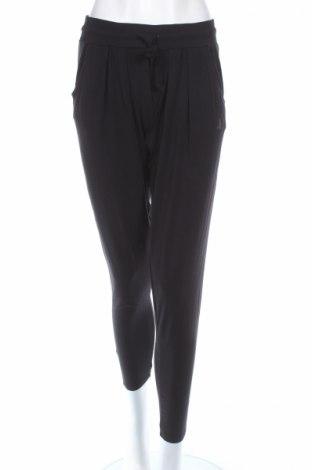 Pantaloni trening de femei Curare