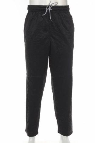 Męskie spodnie sportowe AND1